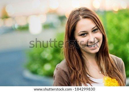 Teenager smiling happy outdoors in a park