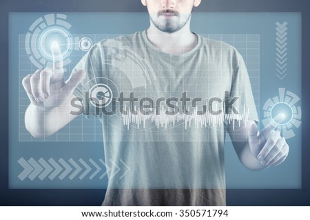 Teenager standing and working wth touch screen technology - stock photo