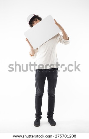 Teenager Stands, Holds and Shows a Blank White Cardboard - stock photo