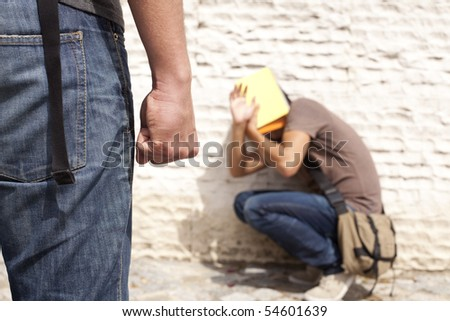 Teenager student with fear at his school (selective focus) - stock photo