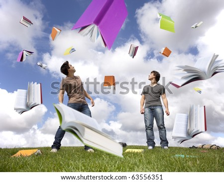 Teenager students outside protecting there heads from a rain of books - stock photo