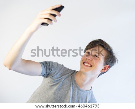 Teenager taking a selfie.