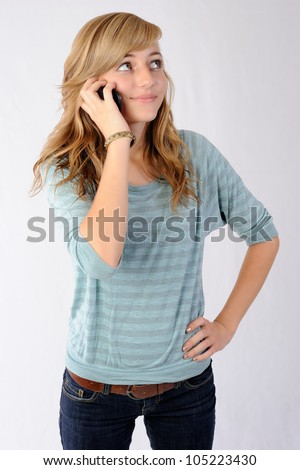 Teenager Talking on Cellphone. Happy teenage girl talking on her cellphone. Note: Not Isolated. - stock photo