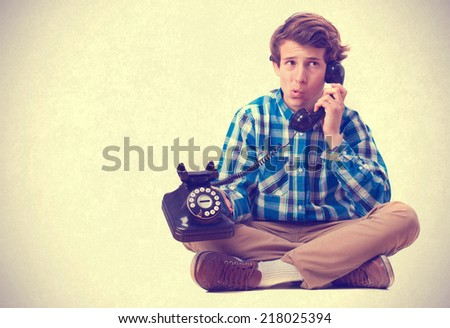 teenager talking on the phone. isolated - stock photo