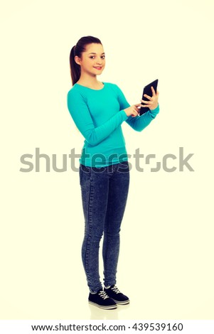 Teenager using a tablet. - stock photo