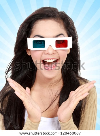 Teenager watching a 3D movie with retro 3D glasses