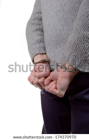 Teenager wearing handcuffs and is caught by the police - stock photo