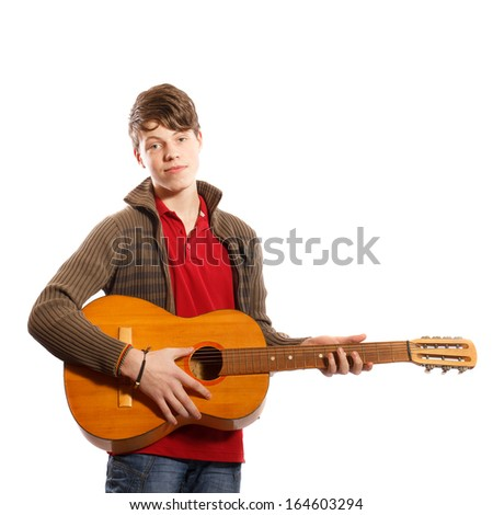 Teenager with a guitar on a white background - stock photo