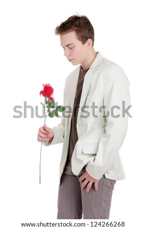 teenager with a red rose, isolated on white