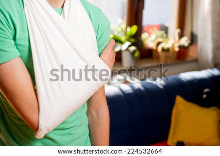 Teenager with arm in a sling. - stock photo