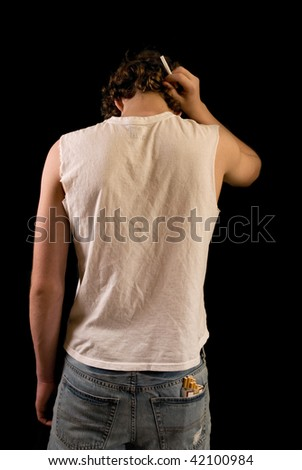 teenager with cigarette, cigarette pack in back pocket - stock photo