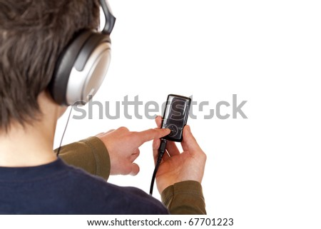 Teenager with headset use mp3 music player. Isolated on white background.