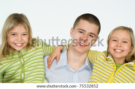 teenager with her sisters on a white background - stock photo