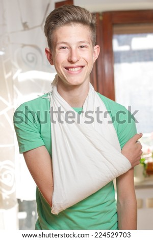 Teenager with his arm in a sling.