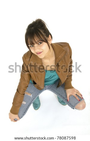 Teenager with leather jacket and jeans on white background
