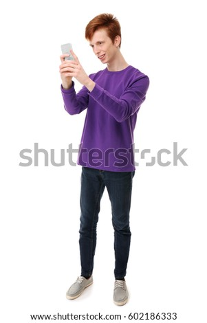 Teenager with mobile phone on white background