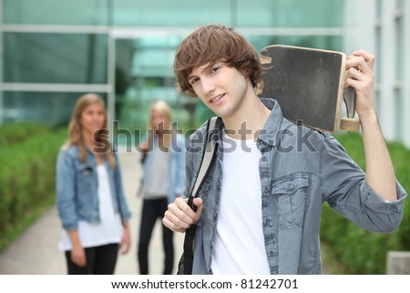 Teenager with skate-board - stock photo