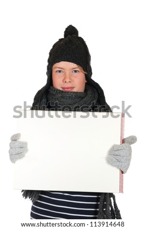 Teenager  with woolen hat and drawing block in front of a white background - stock photo
