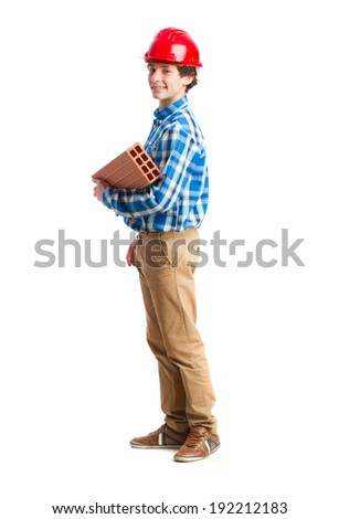 teenager with work helmet and holding a brick. isolated