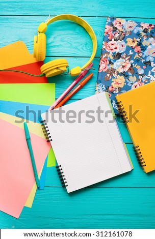 Teenager workspace with open diary and copy space. Top view and headphones. Back to school - stock photo