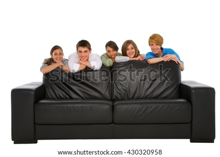 teenagers behind sofa
