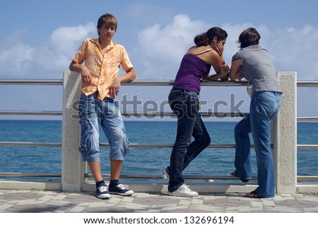 Teenagers boy and girls outdoors - stock photo
