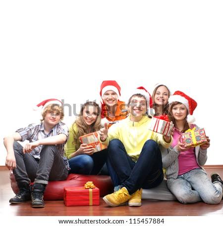 Teenagers celebrate christmas isolated on white - stock photo