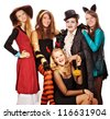 Teenagers dressed in costumes for Halloween  against white background - stock photo