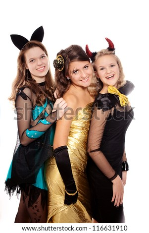 Teenagers dressed in costumes for Halloween  against white background