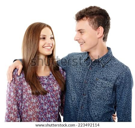 Teenagers friends, boy has his arm around his girlfriend's shoulders - stock photo