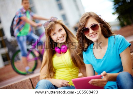 Teenagers hanging out together on a usual summer day, selective focus