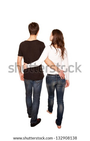 Teenagers in love, boy and girl hugging and walking. Rear view. Ready for your logo, symbol or text. Isolated on white background - stock photo