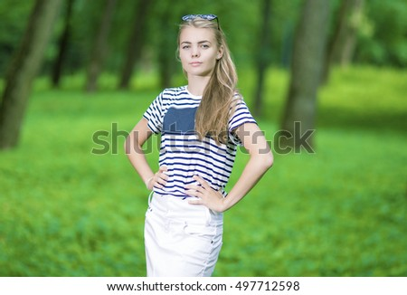 Teenagers Lifestyle Concepts. Portrait of Blond Caucasian Teenager Posing in Green Forest. Horizontal Shot