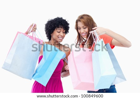 Teenagers looking at the products bought by each other - stock photo