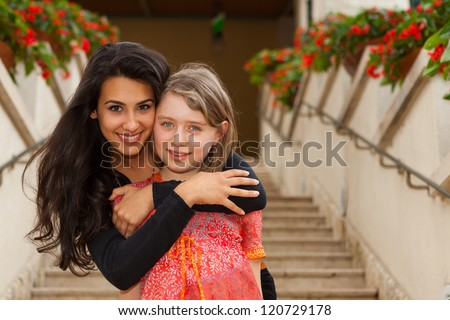 Teenagers outdoors with an affectionate embrace. - stock photo