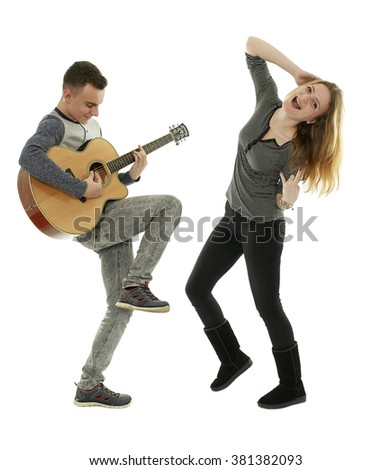 Teenagers playing guitar and dancing, isolated on white background