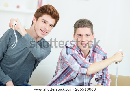 Teenagers playing video games - stock photo