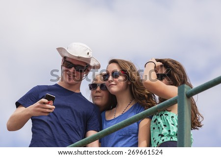 Teenagers Self Photo Teenagers boy girls group mobile self portrait photo summer holidays. - stock photo