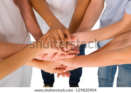 teenagers with hands together - stock photo
