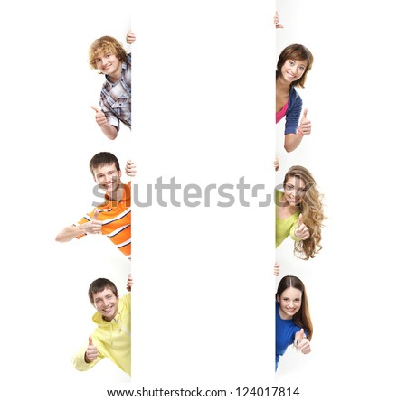Teenagers with the blank white banner. Perfect space to put any text. - stock photo