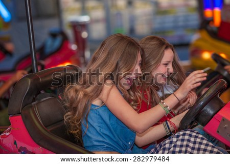 teens having fun at the fair - stock photo