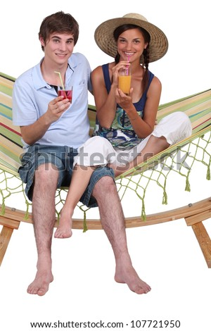 Teens in hammock - stock photo