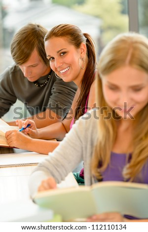 Teens study in high-school library reading student college learning campus - stock photo