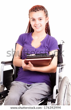 teenwoman on wheelchair, white background - stock photo