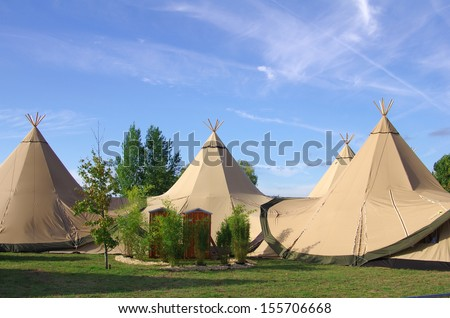 teepees in nature - stock photo