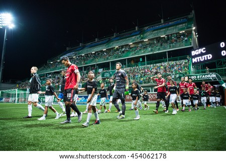 Teerasil Dangda no.10 (RED) of Muangthong United. walk to stadium during  theThai Premier League 2016 Bangkok Glass FC.and Muangthong United at Leo Stadium on June 29,2016 in Thailand - stock photo
