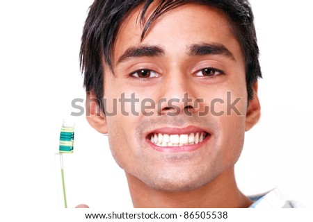 Teeth care young man with toothbrush - stock photo