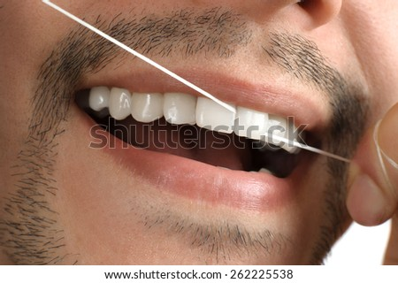 Teeth. Dental floss. - stock photo
