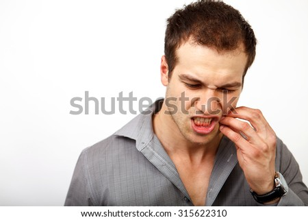 Teeth pain concept - man suffering from dental problems - stock photo