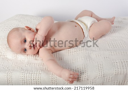 Teething baby with sweet expression - stock photo